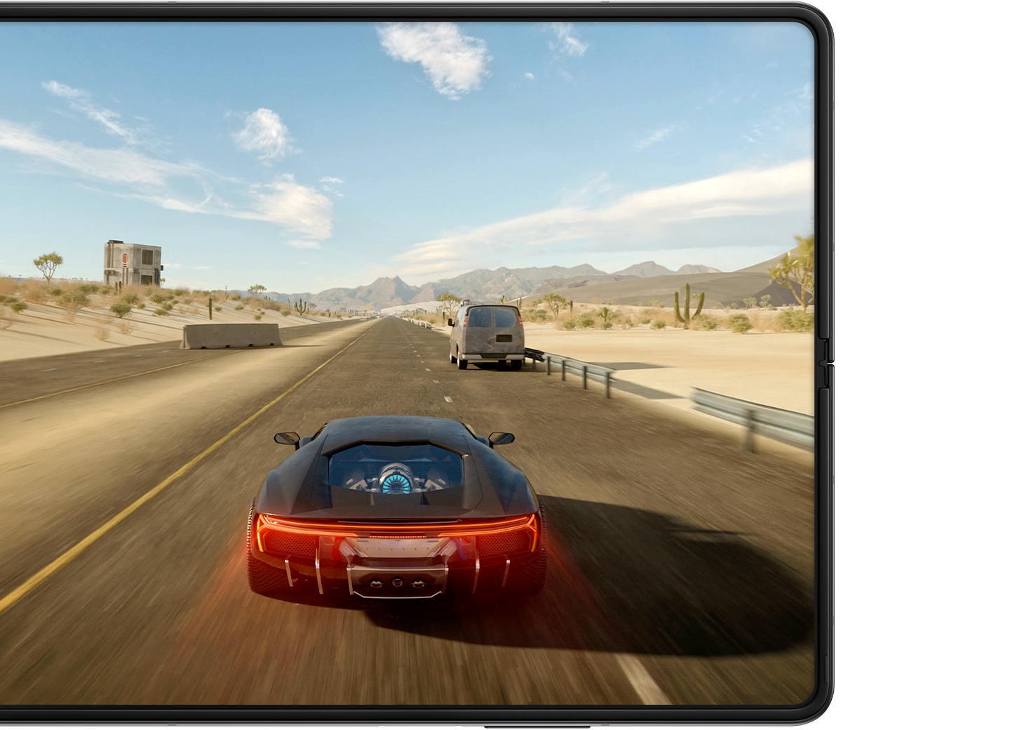 Unfolded Galaxy Z Fold3 5G with a scene from a game of a red car racing down a road on the Main Screen.