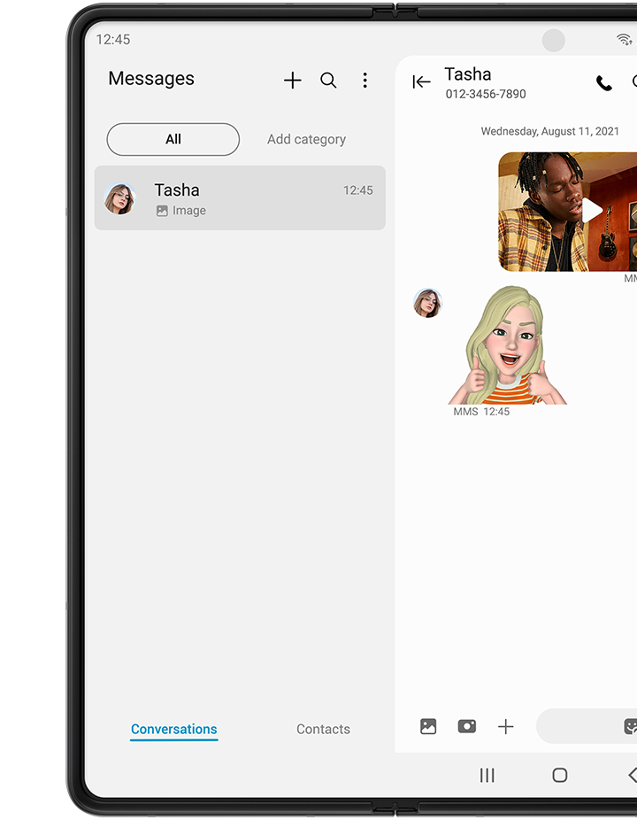 Unfolded Galaxy Z Fold3 5G with Messages app on the Main Screen. It shows a text message conversation with Tasha. The sender has sent the video of a man playing a keyboard and singing into a microphone. Tasha replies with an emoji of her giving a thumbs up.